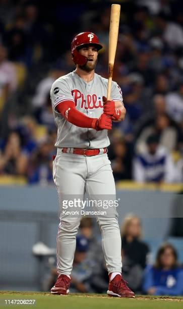 Bryce Harper of the Philadelphia Phillies squeezes the bat during the fourth inning against Los Angeles Dodgers at Dodger Stadium on May 31 2019 in...