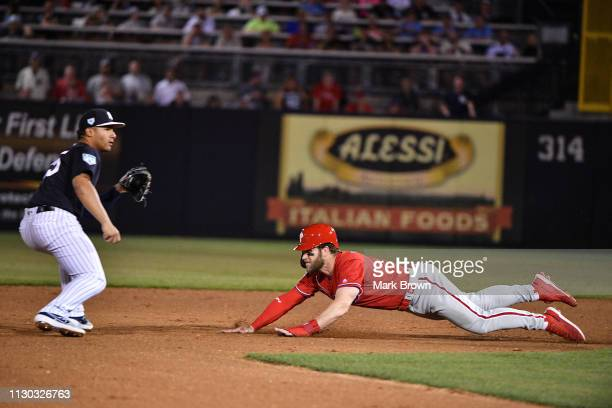 Bryce Harper of the Philadelphia Phillies steals second base in the fifth inning during the spring training game against the New York Yankees at...