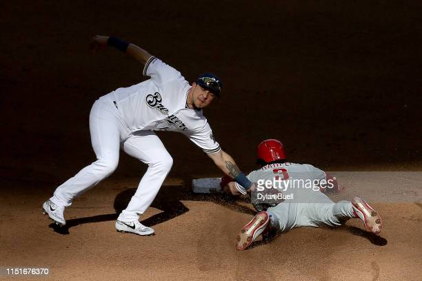 Bryce Harper of the Philadelphia Phillies steals second base past Hernan Perez of the Milwaukee Brewers in the seventh inning at Miller Park on May...