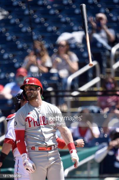 Bryce Harper of the Philadelphia Phillies tosses his bat after striking out in the sixth inning against the Washington Nationals at Nationals Park on...