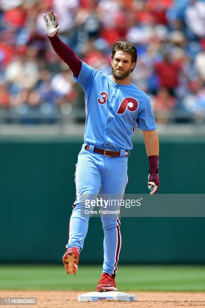 Bryce Harper of the Philadelphia Phillies waves after hitting a double in the fourth inning against the St. Louis Cardinals at Citizens Bank Park on...