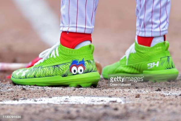 Bryce Harper of the Philadelphia Phillies wears cleats with the Philly Phanatic cleats during the game against the Atlanta Braves on Opening Day at...