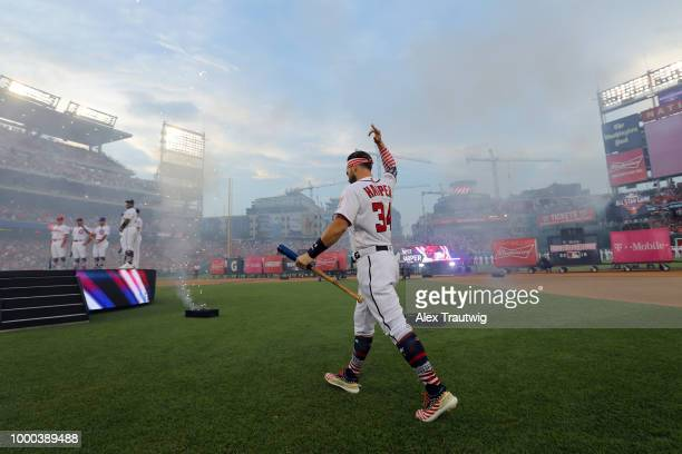 Bryce Harper of the Washington Nationals acknowledges the crowd during player introductions prior to the TMobile Home Run Derby at Nationals Park on...