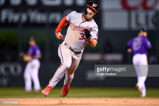 Bryce Harper of the Washington Nationals advances from first to third in the ninth inning of a game against the Colorado Rockies at Coors Field on...