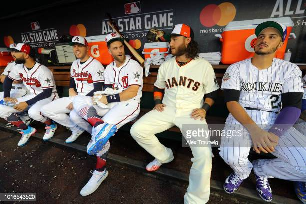Bryce Harper of the Washington Nationals and Brandon Crawford of the San Francisco Giants sit in the dugout before the start of the 89th MLB AllStar...
