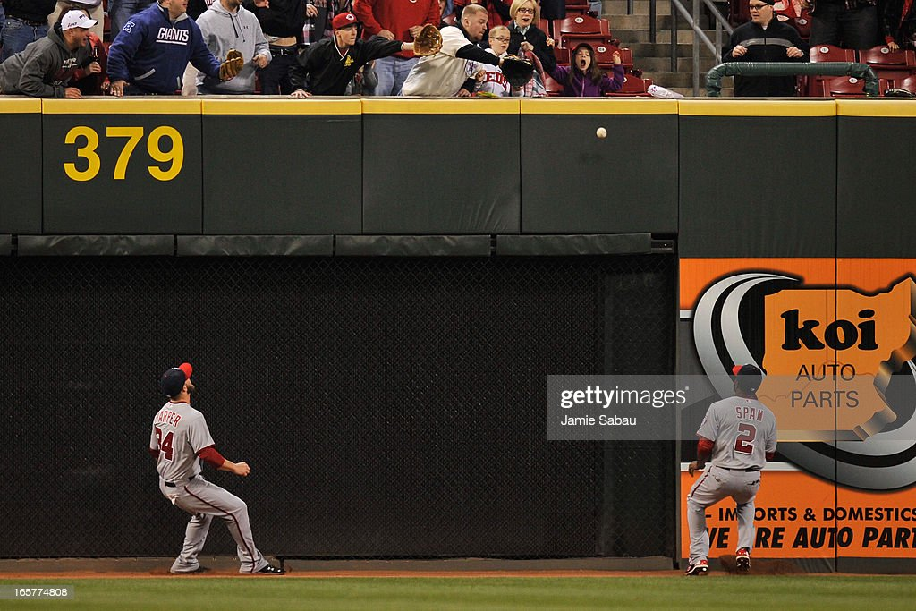 Bryce Harper #34 of the Washington Nationals and Denard Span #2 of the Washington Nationals watch as a ball hit by Jay Bruce #32 of the Cincinnati Reds in the seventh inning bounces off the left field wall for a double at Great American Ball Park on April 5, 2013 in Cincinnati, Ohio. Cincinnati defeated Washington 15-0.