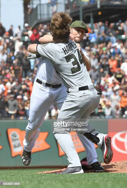 Bryce Harper of the Washington Nationals and Hunter Strickland of the San Francisco Giants throw punches at one another after Strickland hit Harper...