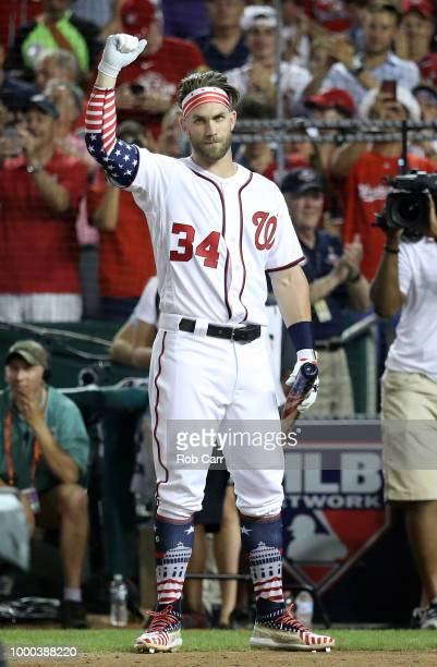 Bryce Harper of the Washington Nationals and National League celebrates after his first round win during the TMobile Home Run Derby at Nationals Park...