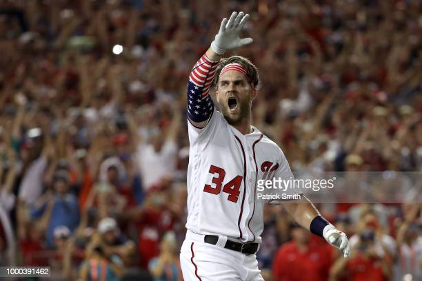 Bryce Harper of the Washington Nationals and National League celebrates after winning the TMobile Home Run Derby at Nationals Park on July 16 2018 in...