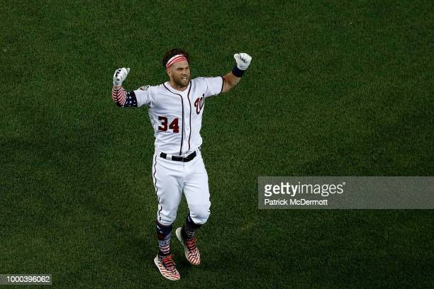 Bryce Harper of the Washington Nationals and National League celebrates after winning the T-Mobile Home Run Derby at Nationals Park on July 16, 2018...