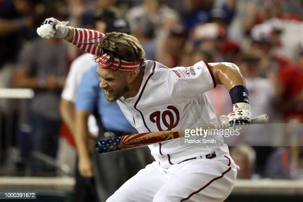 Bryce Harper of the Washington Nationals and National League celebrates in the finals after tying Kyle Schwarber of the Chicago Cubs and National...