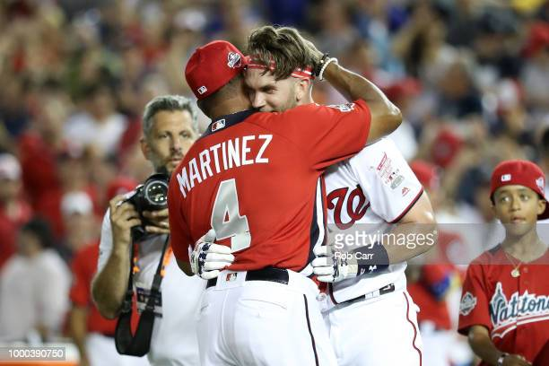 Bryce Harper of the Washington Nationals and National League celebrates with his manager Dave Martinez after winning the TMobile Home Run Derby at...