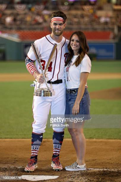 Bryce Harper of the Washington Nationals and National League celebrates with the trophy and wife Kayla Varner after winning the TMobile Home Run...
