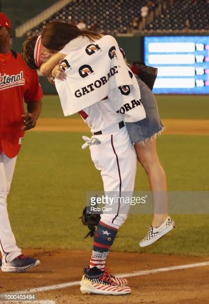 Bryce Harper of the Washington Nationals and National League celebrates with wife Kayla Varner after winning the TMobile Home Run Derby at Nationals...
