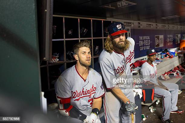 Bryce Harper of the Washington Nationals and team mate Jayson Werth of the Washington Nationals watch play from the dugout as they prepare to bat...