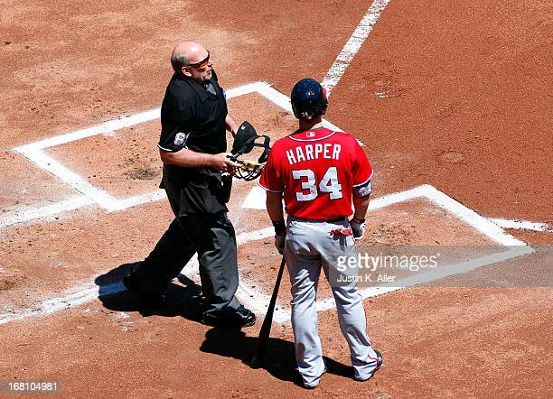Bryce Harper of the Washington Nationals argues a call with home plate umpire Bob Davidson during the game on May 5 2013 at PNC Park in Pittsburgh...