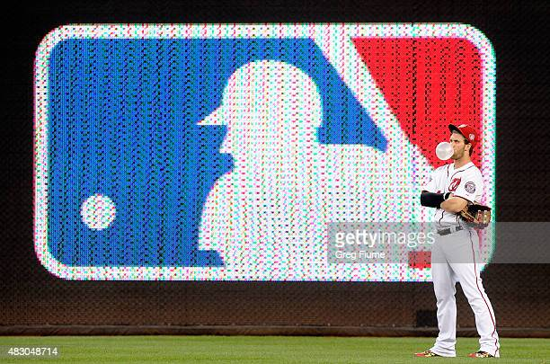 Bryce Harper of the Washington Nationals blows a bubble while waiting for a play to be reviewed in the third inning against the Arizona Diamondbacks...