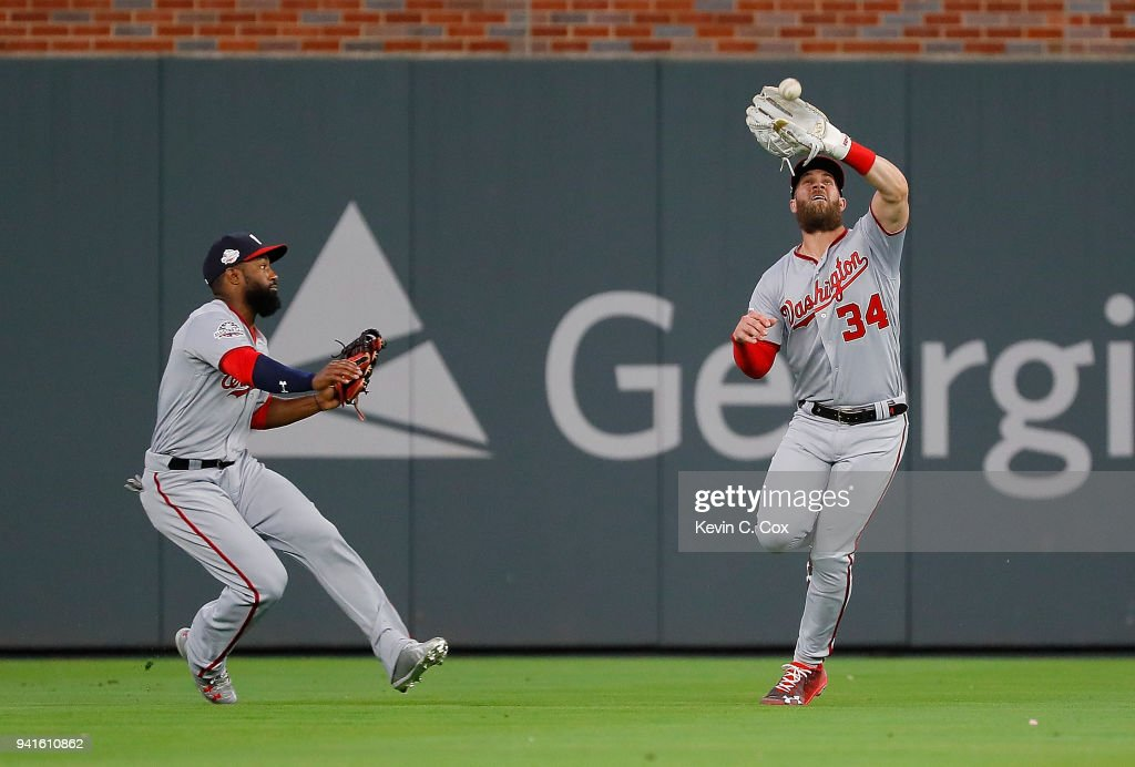Bryce Harper #34 of the Washington Nationals catches a deep fly hit by Ozzie Albies #1 of the Atlanta Braves to the end the third inning in the at SunTrust Park on April 3, 2018 in Atlanta, Georgia.