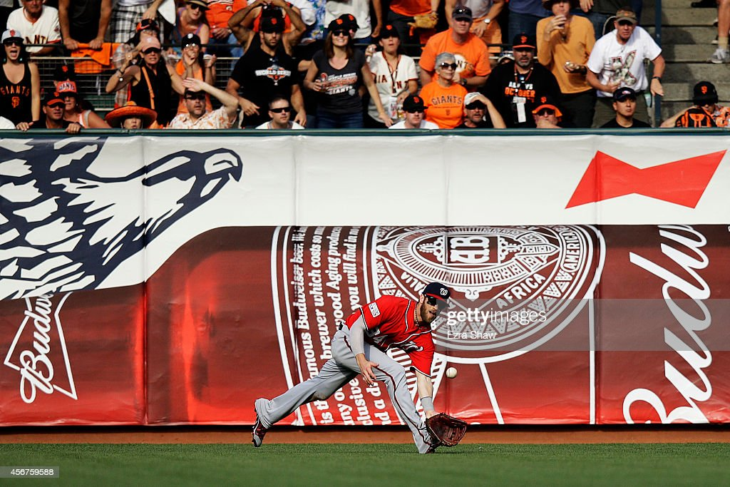 Bryce Harper #34 of the Washington Nationals catches a fly ball for the out on Travis Ishikawa #45 of the San Francisco Giants in the seventh inning during Game Three of the National League Division Series at AT&T Park on October 6, 2014 in San Francisco, California.