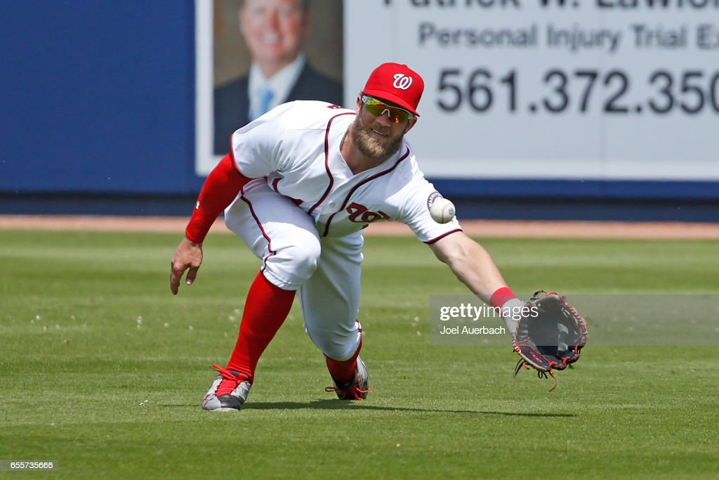 Bryce Harper #34 of the Washington Nationals catches the ball hit by Jason Gurka #72 of the New York Yankees in the fourth inning during a spring training game at The Ballpark of the Palm Beaches on March 20, 2017 in West Palm Beach, Florida. The Yankees defeated the Nationals 9-3.