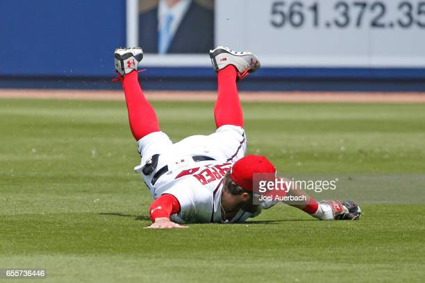 Bryce Harper of the Washington Nationals catches the ball hit by Jason Gurka of the New York Yankees in the fourth inning during a spring training...