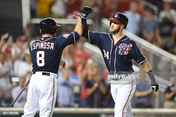 Bryce Harper of the Washington Nationals celebrates a solo home run with Danny Espinosa in the sixth inning during a baseball game against the...