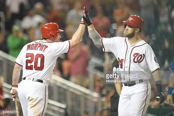Bryce Harper of the Washington Nationals celebrates a two run home run in the fifth inning with Daniel Murphy during a baseball game against the New...