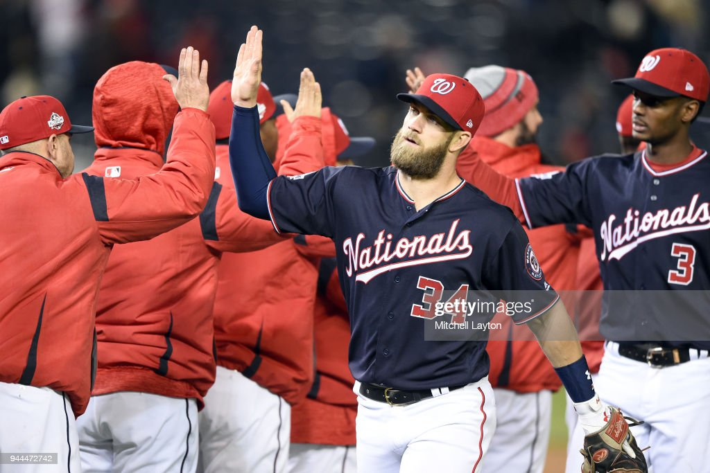 Bryce Harper #34 of the Washington Nationals celebrates a win after a baseball game against the Atlanta Braves at Nationals Park on April 10, 2018 in Washington, DC.