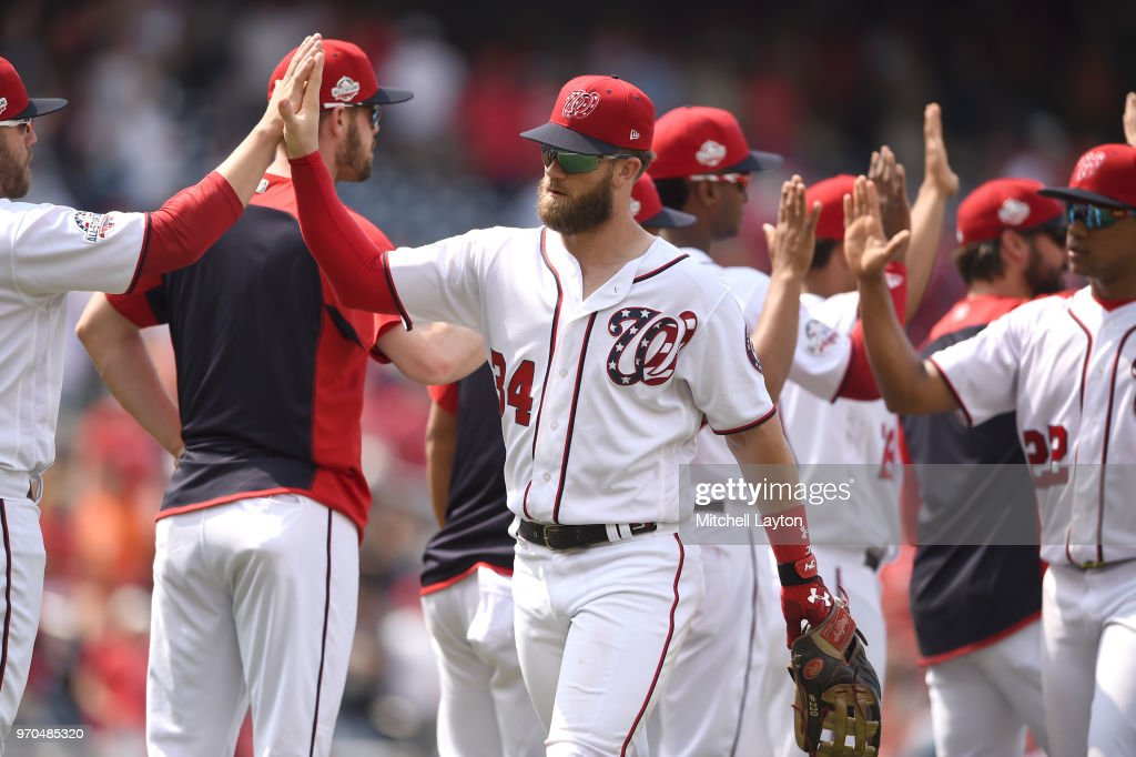 Bryce Harper #34 of the Washington Nationals celebrates a win after a baseball game against the San Francisco Giants at Nationals Park on June 9, 2018 in Washington, DC.