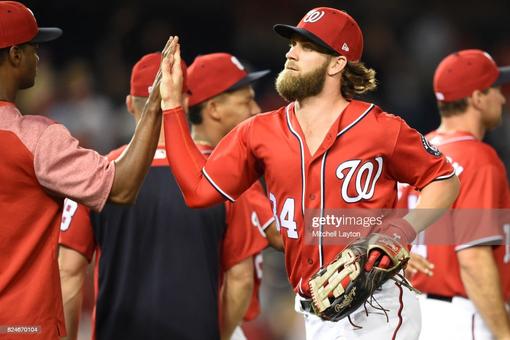 Bryce Harper #34 of the Washington Nationals celebrates a win after game two of a doubleheader against the Colorado Rockies at Nationals Park on July 30, 2017 in Washington, DC.