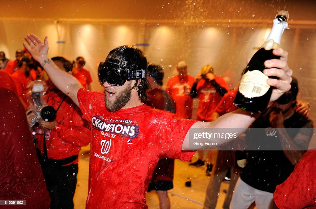 Bryce Harper #34 of the Washington Nationals celebrates after clinching the National League East after the game against the Philadelphia Phillies at Nationals Park on September 10, 2017 in Washington, DC.