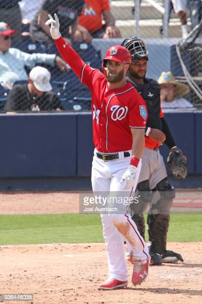 Bryce Harper of the Washington Nationals celebrates after hitting a home run against the Miami Marlins during a spring training game at The Ballpark...