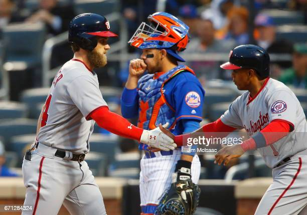 Bryce Harper of the Washington Nationals celebrates his first inning two run home run with teammate Wilmer Difo as Rene Rivera of the New York Mets...