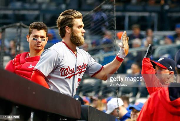 Bryce Harper of the Washington Nationals celebrates his first inning two run home run against the New York Mets at Citi Field on April 21 2017 in the...