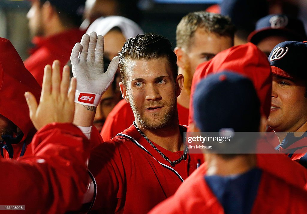 Bryce Harper #34 of the Washington Nationals celebrates his second inning two run home run against the New York Mets at Citi Field on September 13, 2014 in the Flushing neighborhood of the Queens borough of New York City.