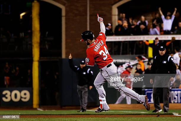 Bryce Harper of the Washington Nationals celebrates his solo home run in the seventh inning against the San Francisco Giants during Game Four of the...