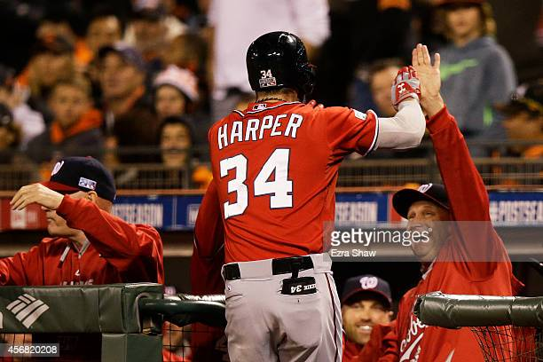 Bryce Harper of the Washington Nationals celebrates his solo home run with manager Matt Williams in the seventh inning against the San Francisco...