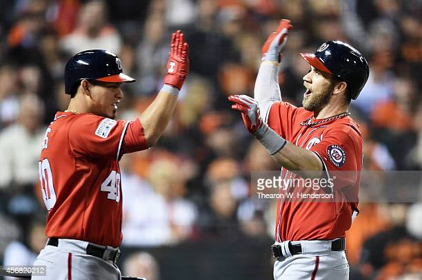 Bryce Harper of the Washington Nationals celebrates his solo home run with Wilson Ramos in the seventh inning against the San Francisco Giants during...