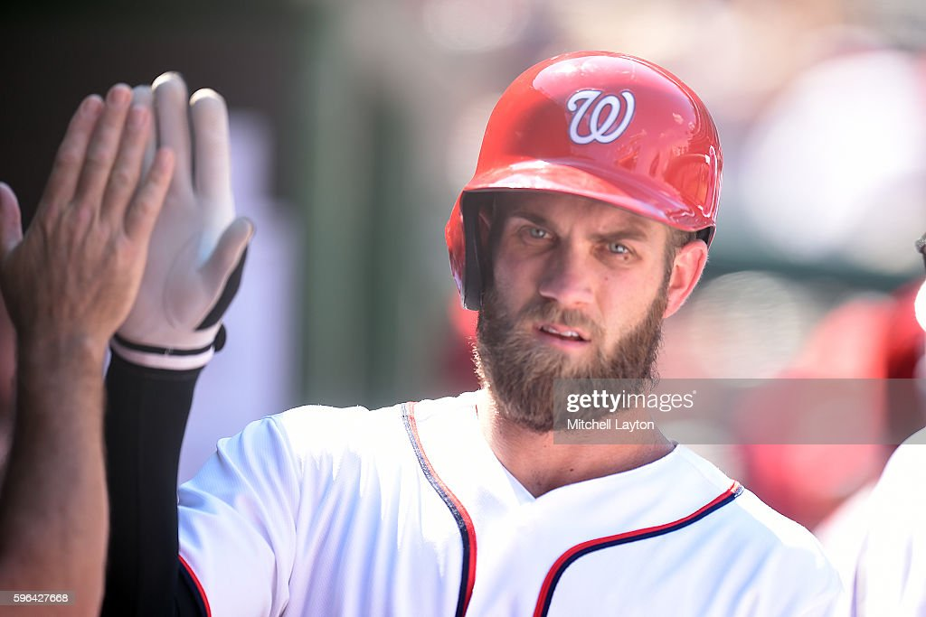 Bryce Harper #34 of the Washington Nationals celebrates scoring on a Wilson Ramos #40 (not pictured) single in the forth inning during a baseball game against the Colorado Rockies at Nationals Park on August 27, 2016 in Washington, DC.