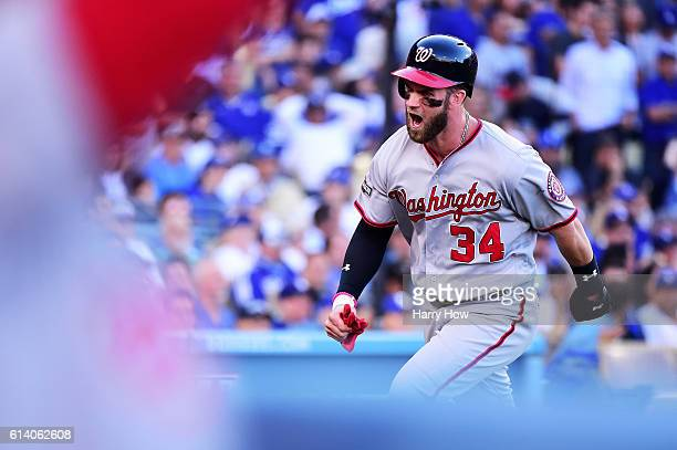 Bryce Harper of the Washington Nationals celebrates scoring on a two RBI single hit by Daniel Murphy in the seventh inning against the Los Angeles...
