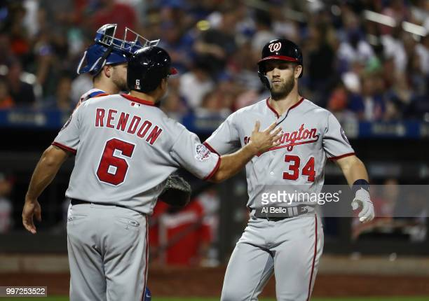 Bryce Harper of the Washington Nationals celebrates with Anthony Rendon after hitting a two run home run against Tim Peterson of the New York Mets in...
