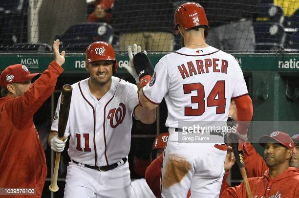 Bryce Harper of the Washington Nationals celebrates with Ryan Zimmerman after scoring in the first inning against the Miami Marlins at Nationals Park...