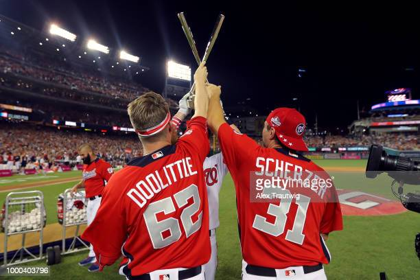 Bryce Harper of the Washington Nationals celebrates with teammate Sean Doolittle and Max Scherzer after winning the TMobile Home Run Derby at...