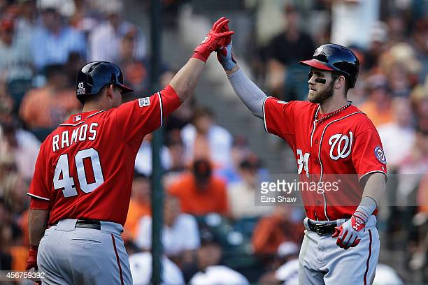 Bryce Harper of the Washington Nationals celebrates with Wilson Ramos after hitting a solo home run in the ninth inning against the San Francisco...