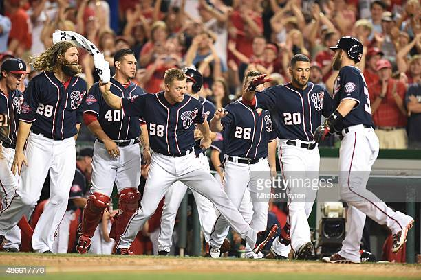 Bryce Harper of the Washington Nationals celebrities with team mates on Michael Taylor of the Washington Nationals walk off three run home run in the...