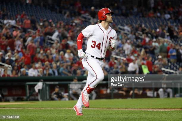 Bryce Harper of the Washington Nationals follows his fourth inning solo home run against the Miami Marlins at Nationals Park on August 7 2017 in...