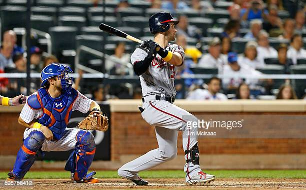 Bryce Harper of the Washington Nationals follows through on a ninth inning double against the New York Mets at Citi Field on September 2 2016 in the...