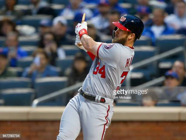 Bryce Harper of the Washington Nationals follows through on his first inning broken bat home run against the New York Mets at Citi Field on April 16...