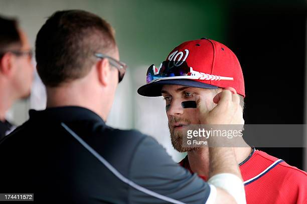 Bryce Harper of the Washington Nationals has eye black put on before the game against the Los Angeles Dodgers at Nationals Park on July 21 2013 in...