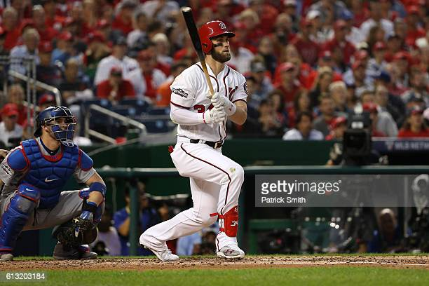 Bryce Harper of the Washington Nationals hits a double against the Los Angeles Dodgers during the third inning in game one of the National League...